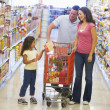Family shopping in supermarket — Stock Photo #4757722