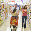 Family shopping in supermarket — Stock Photo #4757723