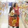 Mother and daughter shopping in supermarket — Stock Photo