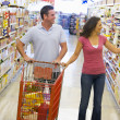 Stock Photo: Couple shopping in supermarket