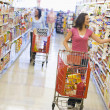 Two women shopping in supermarket — Stock Photo