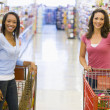 Two women meeting in supermarket — Stock Photo