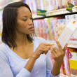 Female shopper checking food labelling — Stock Photo #4757737