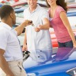 Stock Photo: Young couple collecting new car