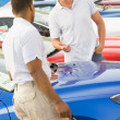 Man talking to car salesman — Stock Photo