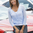 Woman choosing new car — Foto de Stock