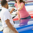 Wompicking up keys to new car — Stock Photo #4757760