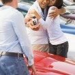 Couple collecting new car from salesman — Stock Photo