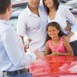 Young family collecting new car — Stock Photo #4757771