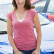 Woman choosing new car — Stockfoto