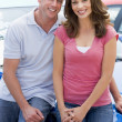 Young couple choosing new car — Foto Stock