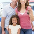Young family collecting new car - Stock Photo