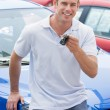 Man picking up new car — Stock Photo