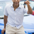 Man picking up new car - Stock Photo