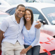 Couple looking at new cars — Stock Photo #4757800