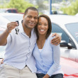 Couple picking up new car — Stok fotoğraf
