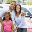 Family on new car lot — Stock Photo #4757804
