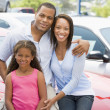 Family on new car lot — Stock Photo