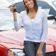 Woman picking up new car - Stock Photo