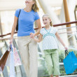 Mother and daughter shopping in mall - Photo