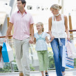 Family shopping in mall - Stock Photo
