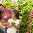 Mother and daughter choosing fresh produce — Stock Photo