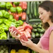 Stock Photo: Womchoosing fresh produce