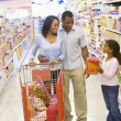 Young family grocery shopping - Stock Photo