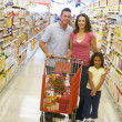 Young family grocery shopping — Stock Photo #4757846