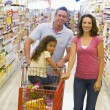 Royalty-Free Stock Photo: Young family grocery shopping