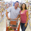 Stock Photo: Young couple grocery shopping