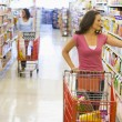 Stock Photo: Women grocery shopping