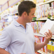 Young man grocery shopping — Stock Photo #4757857