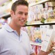 Young man grocery shopping — Stock Photo #4757861