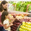 Stock Photo: Mother and daughter shopping for fresh produce