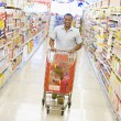 Young man grocery shopping — Stock Photo #4757879