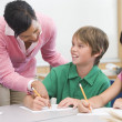 Teacher and pupil in elementary school classroom — Stock Photo #4757919