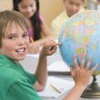 Stock Photo: Elementary school pupil with globe