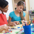 Elementary pupil in art class - Stock Photo