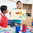 Elementary school pupil in art class - Stock Photo