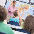 Teacher in elementary school geography class — Stock Photo