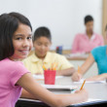 Pupil in elementary school classroom — Stock Photo