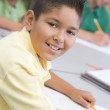 Male pupil in elementary school classroom — Stock Photo
