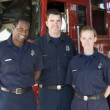 Portrait of firefighters standing by a fire engine — Stock Photo #4758107