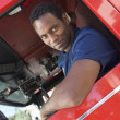 Stock Photo: Firefighter sitting in cab of fire engine