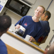 Firefighters relaxing in the staff kitchen — Stock Photo