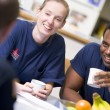 Stock Photo: Firefighters relaxing in staff kitchen