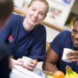Stock Photo: Firefighters relaxing in the staff kitchen