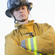 Stock Photo: Portrait of female firefighter