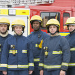 Portrait of a group of firefighters by a fire engine — Foto de Stock